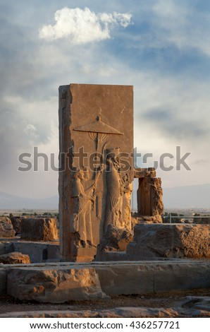 Bas Relief of Achaemenid King With Two Attendants Holding an Umbrella on the Doorway of Hall of Hundred Columns. - stock photo