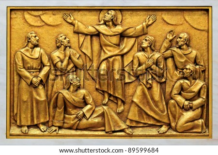 Bas-relief of the Basilica of Fatima representing one of the fourteen mysteries of the rosary (similar to the stations of the cross). This bas-relief depicts Jesus ascended to heaven. - stock photo