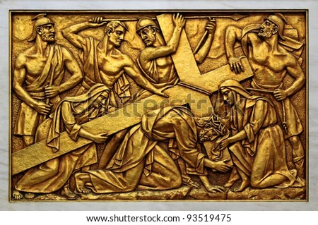 Bas-relief of the Basilica of Fatima representing one of the fourteen mysteries of the rosary (similar to the stations of the cross). This bas-relief depicts Jesus on the way to Calvary. - stock photo