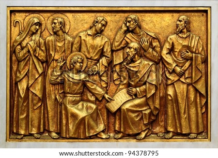 Bas-relief of the Basilica of Fatima representing one of the fourteen mysteries of the rosary (similar to the stations of the cross). This bas-relief depicts young Jesus among the doctors - stock photo