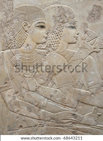 Bas-relief portrait of beautiful young couple with frizzy hair and dreadlocks at the Tomb of Ramose in the ancient egyptian necropolis of the nobles at thebes near Luxor, Egypt - stock photo