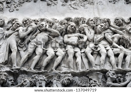 Bas-relief with the Last Judgement image on a facade of the Cathedral Duomo in the city of Orvieto, Umbrija, Italy - stock photo