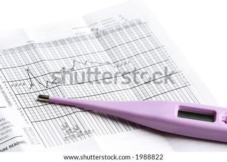 basal thermometer with graphs - stock photo