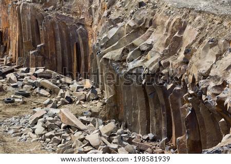 Basalt pillars and some equipment - stock photo