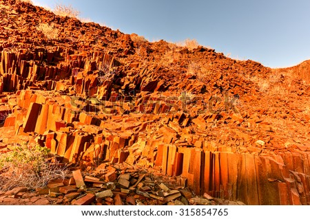 Basalt, volcanic rocks known as the Organ Pipes in Twyfelfontein, Damaraland, Namibia, Southern Africa.