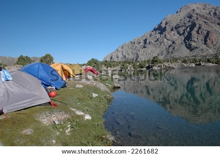 Base camp near cool mountain lake - stock photo