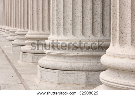Base of columns in front of NYC building - stock photo
