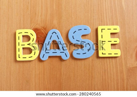 BASE, spell by woody puzzle letters with woody background - stock photo