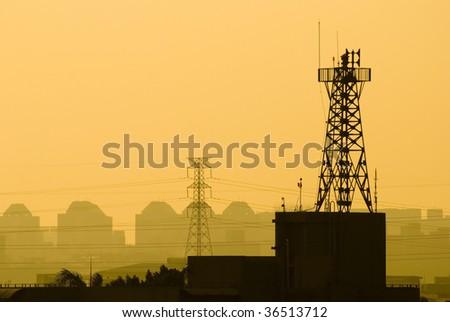 base station of cell phone under sunset, wireless communication - stock photo