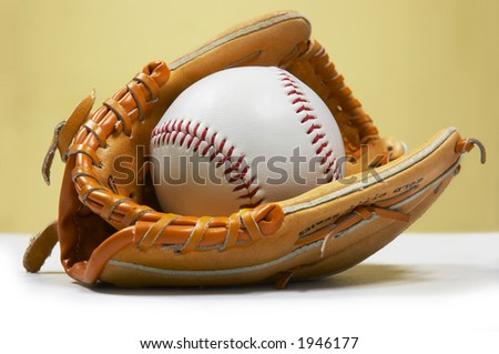 baseball ball in kids sized glove - stock photo