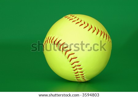 Baseball ball isolated on a green background - stock photo