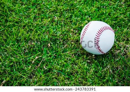 Baseball Ball on Grass Field (in Stadium or Local Field) Sport Concept and Idea / for background, wallpaper, texture. Standard Ball.