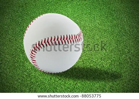 Baseball ball on the grass - stock photo