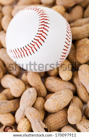 Baseball: Ball with copyspace on peanuts, from above.
