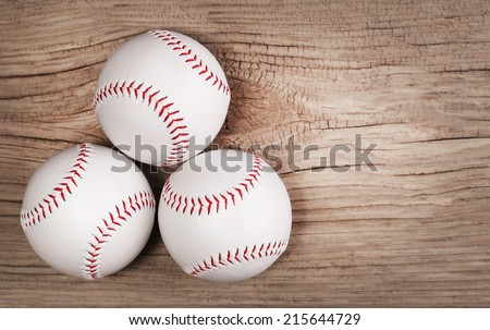 Baseball. Balls on wood background with copy space.  - stock photo