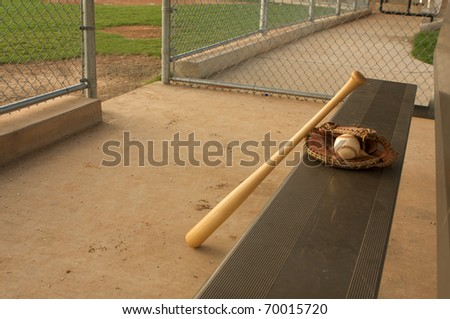 Baseball Bat and Glove on the bench - stock photo