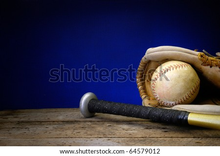 Baseball, bat, and mitt on old vintage wood table with copy space background old rusted screen and neon blue - stock photo