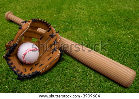 Baseball bat, ball and glove isolated on a field of grass - stock photo