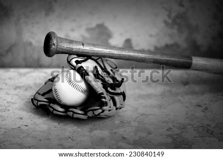 Baseball bat glove and ball on marble and grunge background black and white version - stock photo