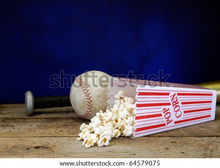 Baseball, bat, mitt, and popcorn on a old vintage set with copy space neon blue background with rusted screen - stock photo