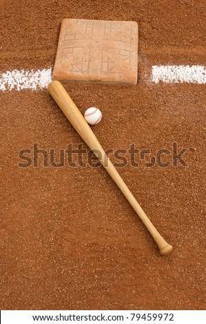 Baseball & Bat near Third Base - stock photo