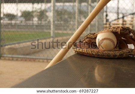 Baseball & Bat on the Bench with the reflection of the ball - stock photo