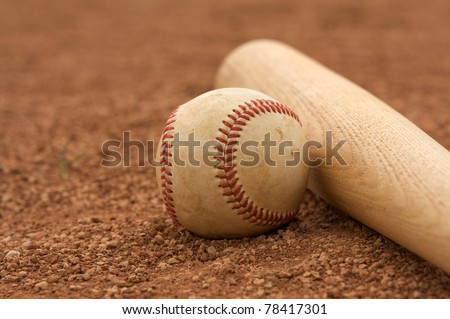 Baseball & Bat on the Infield dirt with room for copy