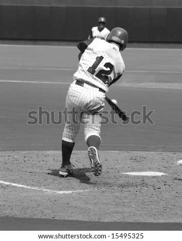 Baseball Batter hitting the ball, black and white - stock photo
