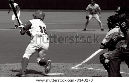 baseball batter hitting the baseball - stock photo