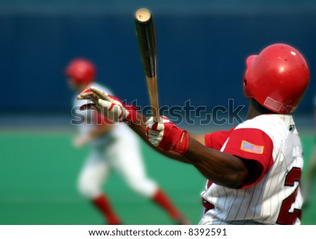 Baseball Batter swinging, close-up - stock photo