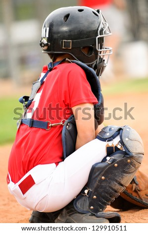 Baseball catcher getting ready to catch the pitch. - stock photo