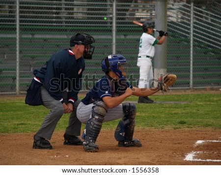 Baseball catcher with umpire