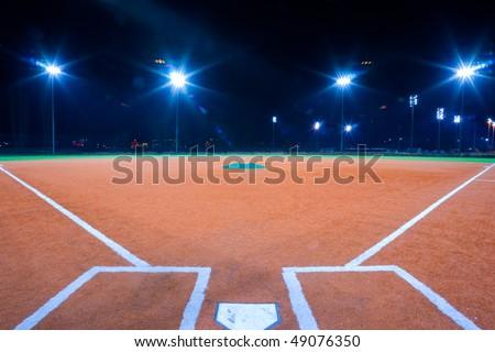 Baseball diamond shot at night from catchers box - stock photo