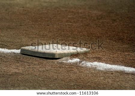 Baseball first base line and bag - stock photo