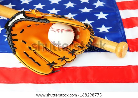 Baseball glove, bat and ball on American flag background - stock photo