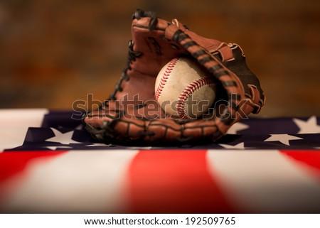 Baseball glove over american flag - stock photo