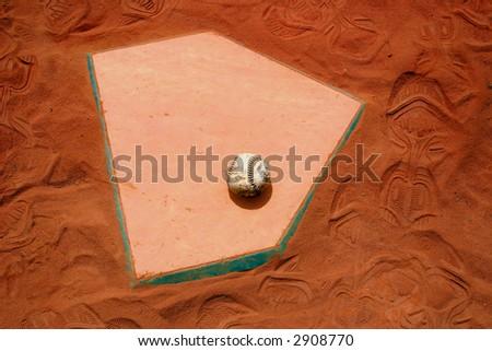 Baseball home plate in red clay. - stock photo