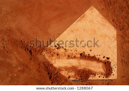 Baseball home plate. Red clay. - stock photo