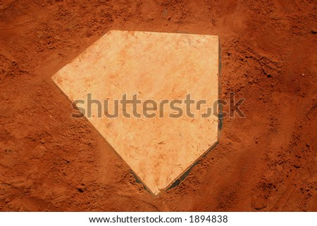 Baseball homeplate in red clay. - stock photo