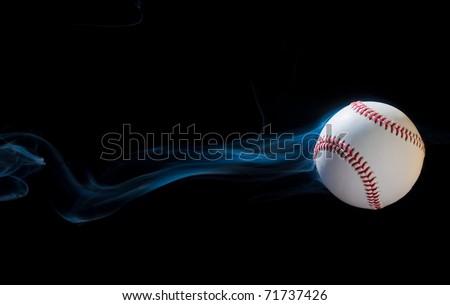 Baseball illusion flying through the black sky. - stock photo