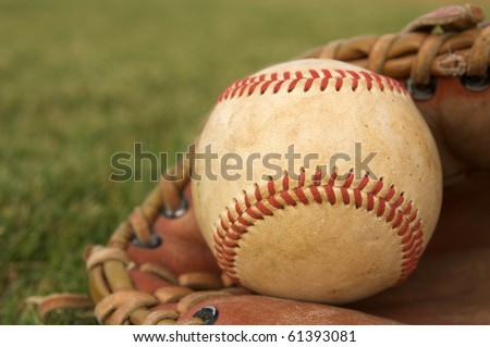 Baseball in a Glove on the field with room for copy