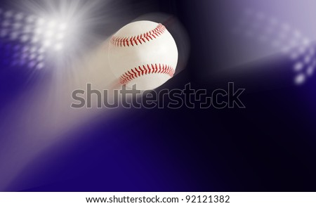 baseball in air against the background of the stadium lights - stock photo