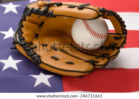 Baseball In An Leather Glove Over American Flag - stock photo