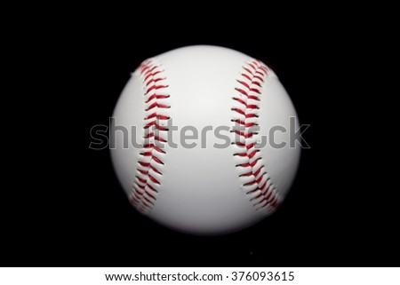 Baseball in black background
