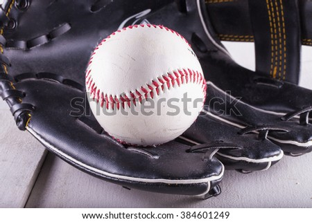 Baseball in black glove, close up, horizontal image - stock photo