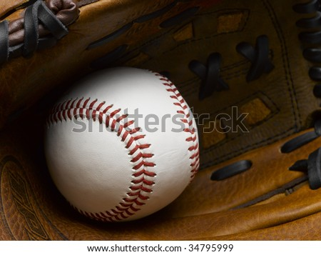 Baseball in glove close-up - stock photo