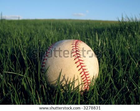 Baseball in Grass 4 of 7 - stock photo