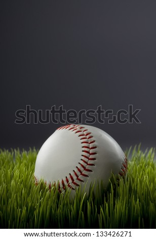 Baseball in grass with room for your type.
