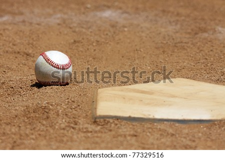 baseball in the dirt at homeplate - stock photo