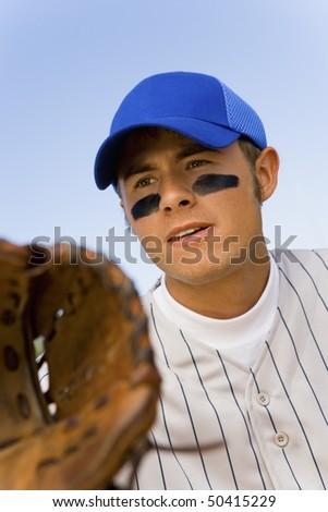 Baseball infielder playing - stock photo